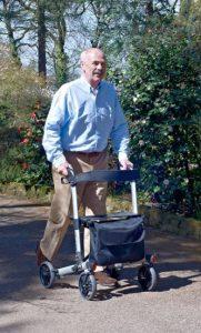 elderly person using upright walker